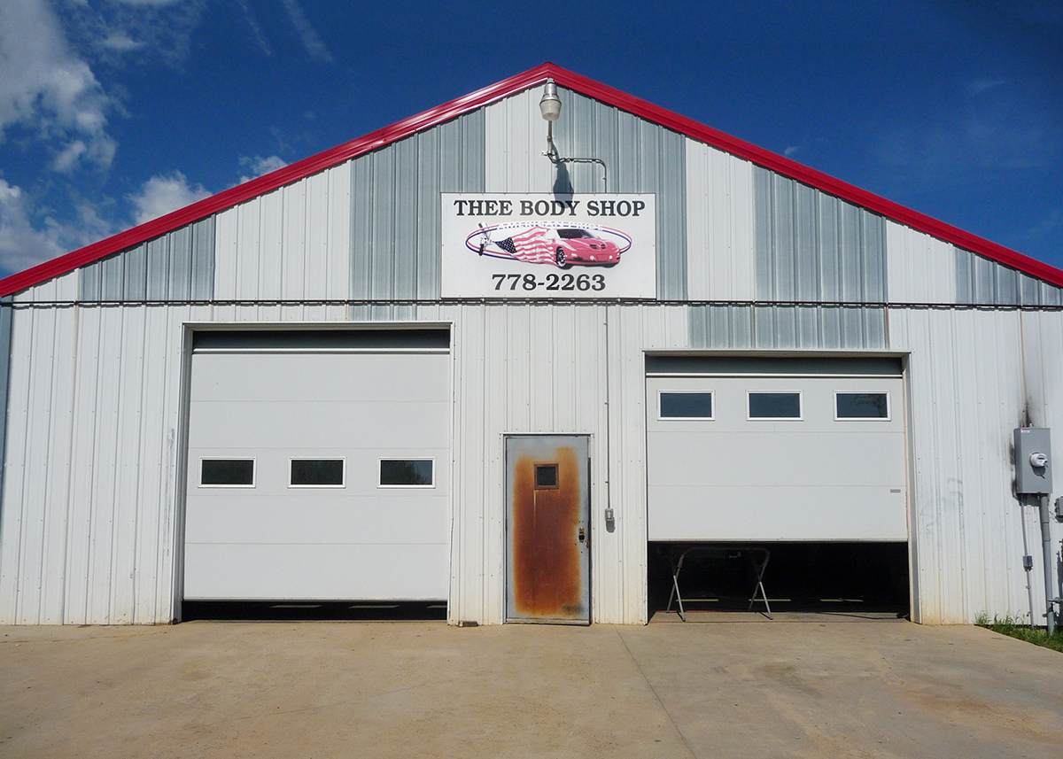 Exterior of THEE Body Shop garage